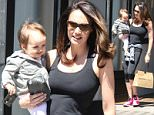 EXCLUSIVE ALL ROUNDER Tamara Ecclestone shops in Notting Hill with her daughter. Young Sophia is obviously picking up shopping tips from her mum as she was seen brandishing Tamara's American Express Centurion card. The Centurion card, also known as the American Express Black Card, is offered by invitation only and apparently requires a minimum annual spend of $250,000USD.\\n27 May 2015.\\nPlease byline: Vantagenews.co.uk
