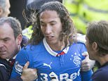 MOTHERWELL, SCOTLAND - MAY 31: Bilel Mohsni for Rangers is taken off the pitch   during the Scottish Premiership Play Off between Motherwell and Rangers at Fir Park on May 31, 2015 in Motherwell, Scotland.  (Photo by Jeff Holmes/Getty Images)