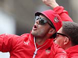 Arsenal's Jack Wilshere, left, celebrates with team mates during their bus top English FA Cup victory parade through the streets of London, Sunday May 31, 2015. Arsenal won a record 12th FA Cup title Saturday with a dominant 4-0 victory over Aston Villa in the final at Wembley Stadium. (Scott Heavey / PA via AP) UNITED KINGDOM OUT - NO SALES - NO ARCHIVES