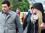 NEWCASTLE, NORTHERN IRELAND - MAY 31: Rory McIlroy of Northern Ireland arrives at the course with new girlfriend Erica Stoll during the fourth round of the Dubai Duty Free Irish Open hosted by the Rory Foundation at Royal County Down Golf Club on May 31, 2015 in Newcastle, Northern Ireland. (Photo by Mark Runnacles/Getty Images)