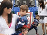 31.MAY.2015 - STUDIO CITY - USA\n*STRICTLY AVAILABLE FOR UK AND GERMANY USE ONLY*\nAMERICAN CRIME STORY' ACTRESS SELMA BLAIR DID A LITTLE SHOPPING AT THE FARMER'S MARKET ON SUNDAY MORNING, ACCOMPANIED BY HER FAVORITE SUPERHERO, HER SON ARTHUR BLEICK, DRESSED IN A CAPTAIN AMERICA COSTUME. THE BRUNETTE BEAUTY LOOKED ADORABLE IN A WHITE EYELET DRESS, SNAKESKIN SANDALS AND A CUTE SNAKESKIN FANNY PACK AS SHE BOUGHT HER SON A SNOW CONE.\nBYLINE MUST READ : XPOSUREPHOTOS.COM\n***UK CLIENTS - PICTURES CONTAINING CHILDREN PLEASE PIXELATE FACE PRIOR TO PUBLICATION ***\n*UK CLIENTS MUST CALL PRIOR TO TV OR ONLINE USAGE PLEASE TELEPHONE 0208 344 2007*\n