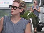 UK CLIENTS MUST CREDIT: AKM-GSI ONLY EXCLUSIVE: Actress and singer Hilary Duff is spotted in an oversized grey t-shirt and green Free City sweatpants as she fills up her vehicle's gas tank in LA.  The pretty blonde went makeup-free as she ran errands on a cloudy Sunday morning.  Pictured: Hilary Duff Ref: SPL1041322  310515   EXCLUSIVE Picture by: AKM-GSI / Splash News