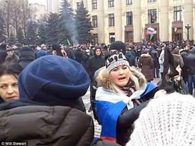 Russian support: She was seen wrapped in a Russian flag appealing for Russian help in Kharkov