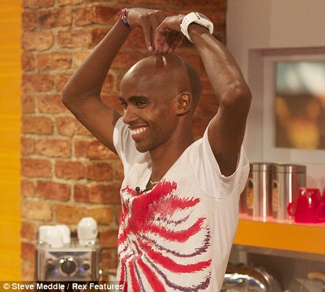 Getting ready to party: Mo Farah was in high spirits as he and millions more descended on London for an epic street party on the streets of the capital city