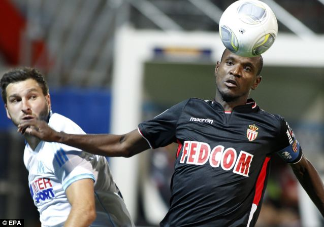 Popular: Olympique Marseille, with players such as Andre Pierre Gignac, pictured left (with Eric Abidal of AS Monaco, right) is one of the best-loved clubs in France