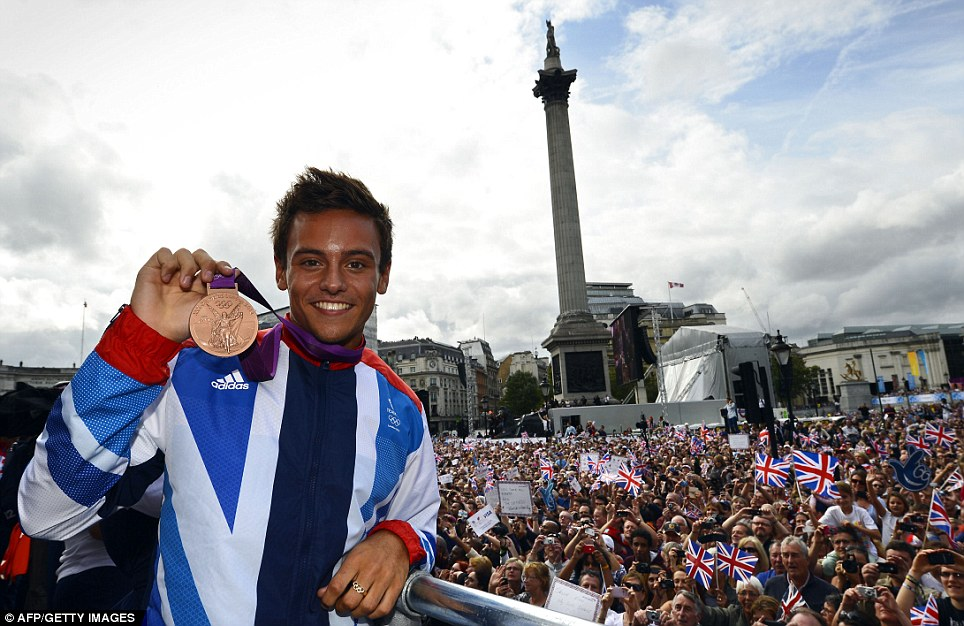 Proud: The likes of Tom Daley were paraded with their medals in front of Team GB's many fans on their way to Buckingham Palace