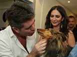 *** MANDATORY BYLINE TO READ: Syco / Thames / Corbis *** Simon Cowell, Lauren Silverman, Louis Tomlinson and Niall Horan of One Direction meet BGT winner Jules and Matisse backstage at the Britain's Got Talent live final on Sunday, May 31st.  Pictured: Simon Cowell and Skippy Ref: SPL1041404  310515   Picture by: Dymond / Syco / Thames / Corbis