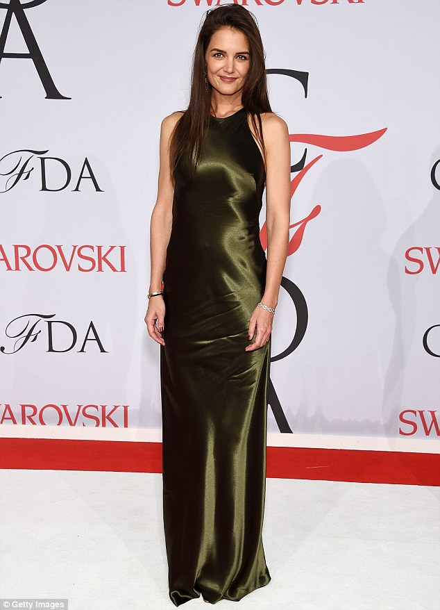 Green sheen: Katie Holmes wore a simple and elegant dark olive green gown from the Ralph Lauren Collection at the CFDA Fashion Awards at Alice Tully Hall in New York's Lincoln Center on Monday