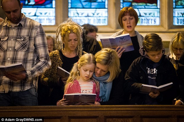 Lots of children were at the service, which was held not far from the school which is closed today