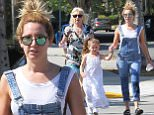 """Picture Shows: Ashley Tisdale  May 31, 2015\n \n """"Scary Movie 5"""" actress Ashley Tisdale is spotted out for lunch with her family in Toluca Lake, California. \n \n Ashley looked cute and casual in denim overalls over a white sleeveless top, black sandals, and mirrored sunglasses.\n \n Exclusive - All Round\n UK RIGHTS ONLY\n \n Pictures by : FameFlynet UK © 2015\n Tel : +44 (0)20 3551 5049\n Email : info@fameflynet.uk.com"""