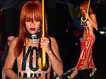 """***MINIMUM FEE TO BE AGREED BEFORE USE***\nEXCLUSIVE: Rihanna was spotted on a ladies night out to Esquelita Club in Midtown, featuring headlining act 'Hunk-O-Mania.' She carried her own umbrella-ella-ella as she headed out into the rainy night wearing a gold dress which read """"You Will Never Own Me"""" in big red letters. Kesha previously wore the same statement dress during Fashion Week. Rihanna showed off her new red hair after spending the week in Cuba for a photoshoot.\n\nPictured: Rihanna\nRef: SPL1040073  010615   EXCLUSIVE\nPicture by: 247PapsTV / Splash News\n\nSplash News and Pictures\nLos Angeles:\t310-821-2666\nNew York:\t212-619-2666\nLondon:\t870-934-2666\nphotodesk@splashnews.com\n"""