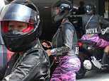 Beverly Hills, CA - Bootylicious babe Amber Rose was spotted driving through Beverly Hills on Monday morning on her Can Am Spyder Roadster bike, dressed suggestively in a skin-tight pink catsuit and motorcycle boots. Behind her helmet, Amber's bleached buzz cut and bleached eyebrows were visible. \nAKM-GSI       June 1, 2015\nTo License These Photos, Please Contact :\nSteve Ginsburg\n(310) 505-8447\n(323) 423-9397\nsteve@akmgsi.com\nsales@akmgsi.com\nor\nMaria Buda\n(917) 242-1505\nmbuda@akmgsi.com\nginsburgspalyinc@gmail.com