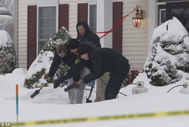 Investigation: Members of the Monroe County Sheriff's Office are pictured investigating the fatal shooting