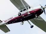 In this photo taken May 26, 2015, a small plane flies near Manassas Regional Airport in Manassas, Va. The plane is among a fleet of surveillance aircraft by the FBI, which are primarily used to target suspects under federal investigation. Such planes are capable of taking video of the ground, and some _ in rare occasions _ can sweep up certain identifying cellphone data. (AP Photo/Andrew Harnik)