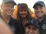 Johnny Depp taking a happy snap with some queensland police officers
