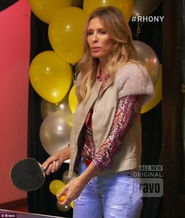 Playing games: Carole played ping-pong with Adam while out on a date together