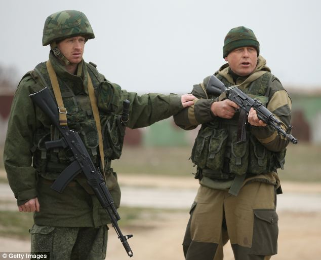 A soldier under Russian command restrains a colleague after he fired his weapon into the air