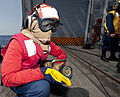 US Navy 110726-N-OV802-156 Ship's Serviceman Seaman Jarvis Jones serves as the nozzleman of a hose team while participating in a helicopter crash.jpg