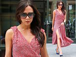***MANDATORY BYLINE TO READ INFPhoto.com ONLY*** Victoria Beckham shows off some leg as she is seen leaving her New York City hotel wearing a red wrap dress and navy heels.  Pictured: Victoria Beckham Ref: SPL1044130  030615   Picture by: INFphoto.com