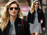 New York, NY - Australian model Jessica Hart shows her stripes as she heads out in the city with a male friend.  Jessica kept herself warm with a cute personalized varsity jacket that had her name scripted on the front and back of the jacket...AKM-GSI          June  3, 2015..To License These Photos, Please Contact :..Steve Ginsburg..(310) 505-8447..(323) 423-9397..steve@akmgsi.com..sales@akmgsi.com..or..Maria Buda..(917) 242-1505..mbuda@akmgsi.com..ginsburgspalyinc@gmail.com..