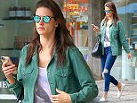 UK CLIENTS MUST CREDIT: AKM-GSI ONLY EXCLUSIVE: Alessandra Ambrosio dresses casual as she visits Nova Era Compounding Pharmacy in Rio de Janeiro, Brazil. She wore a green jacket over a graphic top, dark skinny jeans and white flats.  Pictured: Alessandra Ambrosio Ref: SPL1043469  020615   EXCLUSIVE Picture by: AKM-GSI / Splash News