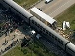 An Amtrak train collided Friday afternoon with the trailer of a truck that was obstructing the tracks, officials said. The train was passing through Wilmington, southwest of Chicago, when it collided with a truck near Illinois Route 53 and River Road. The trailer of the truck was overturned and split open, with its contents strewn about an embankment. The cab of the truck was separated from the trailer and came to rest on the opposite side of the train.   Source: http://www.nbcchicago.com/news/local/amtrak-crash-306324891.html#ixzz3cEEcogd6  Follow us: @nbcchicago on Twitter | nbcchicago on Facebookimage003.jpg