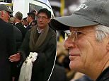 U.S. actor Richard Gere watches as the exiled Tibetan spiritual leader the Dalai Lama (unseen) is surrounded by supporters and security staff after arriving at Sydney International airport June 4, 2015, at the start of a twelve-day visit to Australia. REUTERS/David Gray