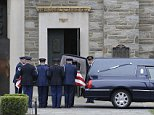An honor guard carries a casket containing the remains of former Delaware Attorney General Beau Biden into St. Anthony of Padua Roman Catholic Church before a viewing, Friday, June 5, 2015, in Wilmington, Del. Biden, the eldest son of the vice president, died of brain cancer Saturday at age 46. (AP Photo/Patrick Semansky)