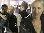 UK CLIENTS MUST CREDIT: AKM-GSI ONLY\nEXCLUSIVE: Charlize Theron runs into Aaron Paul and his wife Lauren Parsekian at the U2 concert in Inglewood, CA.\n\nPictured: Charlize Theron, Aaron Paul and Lauren Parsekian\nRef: SPL1045268  030615   EXCLUSIVE\nPicture by: AKM-GSI / Splash News\n\n