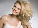 Female beauty drying hair --- Image by � Henry Arden/cultura/Corbis
