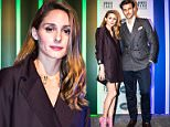 """Fashionista Olivia Palermo looks stylish in an oversized Tibi tuxedo dress as she poses with her heartthrob husband Johannes Huebl and a selection of classic cars. The reality TV couple appear next to the selection of vintage vehicles from the 1950s and 1960s at an event in New York City. The cars were the inspiration for a range of razors from the high-end brand The Art of Shaving with each piece named after an iconic motoring colour of the era Signal Red, Royal Blue and British Racing Green. """"We love the racecar-themed names,"""" said Palermo, 29, who called them a """"fashion-forward twist"""" for a daily grooming routine. """"They are fun for every gentleman who prefers the proper wet shave,"""" said Huebl. CREDIT: Ben Draper/Splash \n\nPictured: Olivia Palermo and Johannes Huebl in NYC for an The Art of Shaving event. Olivia wears: Dress: Black tuxedo dress by Tibi. Shoes: Pink caged heels by Schutz. Bracelets: Matching embellished cuffs by Miriam Haskell. Purse: Black clutch by Hayward\nR"""