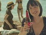 """OK"" with Dakota Johnson and directed by Quim Guti�rrez A. Amen?bar. Estrella Damm 2015\nDakota Johnson in new advert for Estrella bear \nGrab from YouTube\n\n@Izraella  \n"