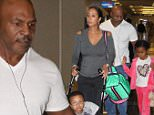 Picture Shows: Lakiha Spicer, Morocco Tyson, Mike Tyson, Milan Tyson  June 04, 2015\n \n Former Heavyweight Champion Of The World Mike Tyson, his wife Lakiha 'Kiki' Spicer and their children Milan and Morocco arriving on a flight at the Washington Reagan National Airport in Washington DC. Mike held his daughter Milan's hand as they made their way through the airport. \n \n Non Exclusive\n UK RIGHTS ONLY\n \n Pictures by : FameFlynet UK © 2015\n Tel : +44 (0)20 3551 5049\n Email : info@fameflynet.uk.com