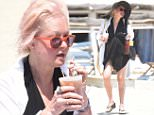 OIC - XCLUSIVEPIX.COM - EXCLUSIVE - MUST AGREE BEFORE USAGE - CALL 077688 36669 -  Cindy Lauper seen with her husband David Thornton enjoying the sun on the beach at club 55 in St Tropez on the 3rd June 2015. Photo XclusivePix 077688 36669/0203 174 1069
