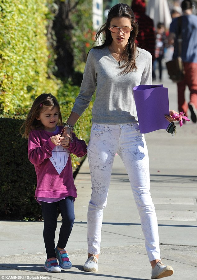 Less than romantic reality: Meanwhile, Ambrosio was spotted in Brentwood Friday escorting her five-year-old daughter Anja to school