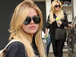 Beverly Hills, CA - Khloe Kardashian stopped by Meche Hair Salon in Beverly Hills, emerging with bright blonde locks and a big smile on her face.\nAKM-GSI          June 4, 2015\nTo License These Photos, Please Contact :\nSteve Ginsburg\n(310) 505-8447\n(323) 423-9397\nsteve@akmgsi.com\nsales@akmgsi.com\nor\nMaria Buda\n(917) 242-1505\nmbuda@akmgsi.com\nginsburgspalyinc@gmail.com