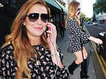 04.JUNE.2015 - LONDON - UK *EXCLUSIVE ALL ROUND PICTURES* AMERICAN ACTRESS LINDSAY LOHAN IS SEEN TALKING ON HER MOBILE PHONE AS SHE LEAVES THE IVY CHELSEA GARDEN RESTURANT WITH A FEMALE FRIEND IN LONDON. LINDSAY SHOWED OFF HER LEGS IN A SHORT FLORAL DRESS AND BALCK LEATHER BOOTS. BYLINE MUST READ : XPOSUREPHOTOS.COM ***UK CLIENTS - PICTURES CONTAINING CHILDREN PLEASE PIXELATE FACE PRIOR TO PUBLICATION *** **UK CLIENTS MUST CALL PRIOR TO TV OR ONLINE USAGE PLEASE TELEPHONE 0208 344 2007**