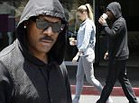 Beverly Hills, CA - Australian beauty Paige Butcher and longtime boyfriend Eddie Murphy go for a quick coffee run at their local Starbucks.  The pretty model went casual in a denim on denim get-up consisting of a light denim jacket, white tank, light grey skinny jeans with matching high-top sneakers, while Eddie Murphy wore black from head to toe. \nAKM-GSI         June 6, 2015\nTo License These Photos, Please Contact :\nSteve Ginsburg\n(310) 505-8447\n(323) 423-9397\nsteve@akmgsi.com\nsales@akmgsi.com\nor\nMaria Buda\n(917) 242-1505\nmbuda@akmgsi.com\nginsburgspalyinc@gmail.com