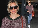EXCLUSIVE ALL ROUNDER Sienna Miller is seen landing at heathrow airport with her daughter in london, sienna looked happy after taking a holiday after being a judge at the cannes film festival. 8 June 2015. Please byline: Vantagenews.co.uk UK clients should be aware children's faces may need pixelating.