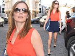 Picture Shows: Geri Halliwell  June 07, 2015\n \n Singer and former Spice Girl Geri Halliwell is spotted leaving a hotel in London, England.\n \n The star, who married Formula One boss Christian Horner last month, looked cool and casual in a sleeveless orange blouse, navy blue shorts, nude pumps with black toe caps and aviator sunglasses.\n \n Non Exclusive\n WORLDWIDE RIGHTS\n \n Pictures by : FameFlynet UK © 2015\n Tel : +44 (0)20 3551 5049\n Email : info@fameflynet.uk.com