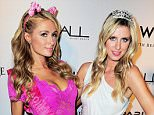 MIAMI BEACH, FL - JUNE 06:  Paris Hilton and Nicky Hilton (R) attend the Paris Hilton Debuts New Single at Wall at W Hotel on June 6, 2015 in Miami Beach, Florida.  (Photo by Sergi Alexander/Getty Images)