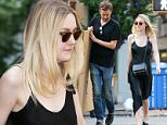 Picture Shows: Dakota Fanning  June 08, 2015\n \n Actress Dakota Fanning is spotted out and about in New York City, New York. Dakota looked stylish in a simple black midi dress.\n \n Non Exclusive\n UK RIGHTS ONLY\n \n Pictures by : FameFlynet UK © 2015\n Tel : +44 (0)20 3551 5049\n Email : info@fameflynet.uk.com
