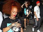 West Hollywood, CA - Rihanna enjoyed a late night out with Real Madrid footballer, Karim Benzema, at Hooray Henry's Nightclub in West Hollywood. The power duo recently sparked dating rumors after they were spotted together in NYC. The 27-year-old pop star looked stylish in a graphic t-shirt dress emblazoned with the face of Catwoman, a trio of necklaces and a pair of golden hoop earrings. Rihanna and Karim reportedly were seated together and having a good time inside the nightclub, but left in separate SUVís.\nAKM-GSI          June 8 2015\nTo License These Photos, Please Contact :\nSteve Ginsburg\n(310) 505-8447\n(323) 423-9397\nsteve@akmgsi.com\nsales@akmgsi.com\nor\nMaria Buda\n(917) 242-1505\nmbuda@akmgsi.com\nginsburgspalyinc@gmail.com