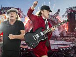 """In this picture made available Saturday, June 6, 2015, the Australian hard rock band AC/DC performs on stage during the concert at Letzigrund stadium in Zurich, Switzerland, Friday, June 5, 2015. The band introduced its latest album """"Rock or Bust"""". (Ennio Leanza/Keystone via AP)"""