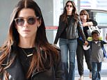 7.JUNE.2015 - NEW YORK - USA\n*STRICTLY AVAILABLE FOR UK AND GERMANY USE ONLY*\n** EXCLUSIVE ALL ROUND PICTURES **\nAMERICAN ACTRESS SANDRA BULLOCK AND LOUIS BARDO BULLOCK, ALONG WITH THEIR LOYAL BODYGUARD, HOLD HANDS, AS THE FASHIONABLE TRIO ARRIVE AT JFK AIRPORT PRIOR TO A DEPARTING FLIGHT. SANDRA WAS WEARING A BLACK LEATHER JACKET WITH JEANS AND SUNGLASSES.\nBYLINE MUST READ : XPOSUREPHOTOS.COM\n***UK CLIENTS - PICTURES CONTAINING CHILDREN PLEASE PIXELATE FACE PRIOR TO PUBLICATION ***\n*UK CLIENTS MUST CALL PRIOR TO TV OR ONLINE USAGE PLEASE TELEPHONE 0208 344 2007*\n