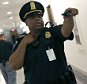 """WASHINGTON, DC - JUNE 09:  U.S. Capitol Hill police direct members of the public away from an office where a suspicious package was identified near where the Senate Homeland Security and Governmental Affairs Committee was holding a hearing in the Dirksen Senate Office Building June 9, 2015 in Washington, DC.  Several floors of the Senate office building were evcauated after a call about a suspicious package. The committee heard testimony on """"Oversight of the Transportation Security Administration: First-Hand and Government Watchdog Accounts of Agency Challenges.""""  (Photo by Win McNamee/Getty Images)"""