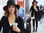 Jessica Alba sips on a Starbucks as she gets her own luggage at JFK airport in NYC.\n\nPictured: Jessica Alba\nRef: SPL1048622  080615  \nPicture by: Ron Asadorian / Splash News\n\nSplash News and Pictures\nLos Angeles: 310-821-2666\nNew York: 212-619-2666\nLondon: 870-934-2666\nphotodesk@splashnews.com\n