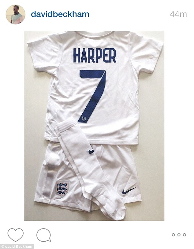 Personalised kit: Harper Beckham has been handed her own mini football kit from the England Women's World Cup team so she can follow in her father's footsteps