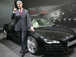 Rupert Stadler, CEO of car manufacturer Audi group, poses in front of a R8 sports car at the company's headquarters in Ingolstadt, southern Germany, Wednesday, Feb. 28, 2007 prior to the annual press conference. The Audi group achieved a new revenue record level of eur 31.1 billion Euro (US$41.02 billion) in the 2006 financial year. (AP Photo/Diether Endlicher)