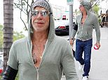 EXCLUSIVE: Mickey Rourke seen leaving lunch in Beverly Hills.  Pictured: Mickey Rourke Ref: SPL1049874  090615   EXCLUSIVE Picture by: KAT / Splash News  Splash News and Pictures Los Angeles: 310-821-2666 New York: 212-619-2666 London: 870-934-2666 photodesk@splashnews.com